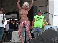 Topless girls dance for biker dudes on stage tubes