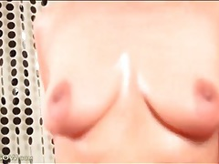 Shaved and pierced mature cunt sits on dick tubes