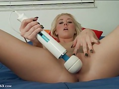 Teen relaxes in bed and toys her pussy tubes