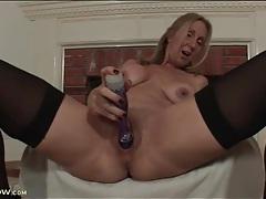 Purple dildo penetrates wet milf pussy tubes
