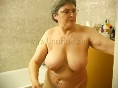 Grandma strips from robe and masturbates pussy tubes