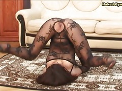 Flexible girl is sexy in black body stocking tubes