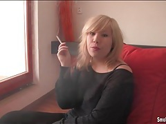 Curvy blonde smokes with her big tits out tubes