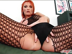 Tattooed redhead reamed out in threesome tubes