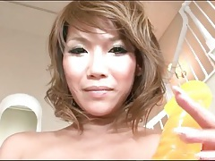 Japanese babe oils up and fucks her dildo tubes