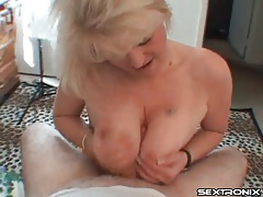 Mature cocksucker with big tits around his dick tubes