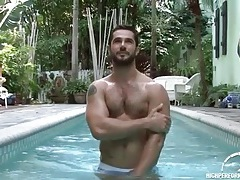 Hot bearded guy in the pool and shower tubes