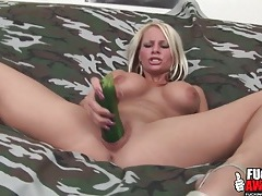 Beautiful blonde fucks her pussy with a zucchini tubes