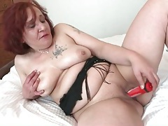 Chubby mature redhead fucks her favorite toy tubes