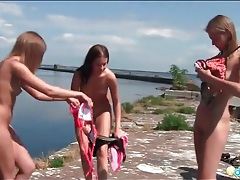 Small tits teens in bikinis on a boat tubes