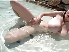 Lucie wilde toys her tight pussy in the pool tubes