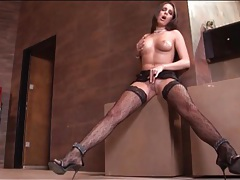 Leggy girl in sexy patterned stockings and heels tubes