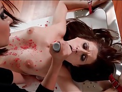 Bound brunette beauty covered in hot wax tubes