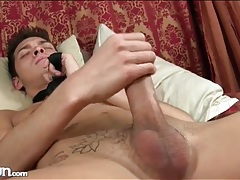 Twink wears only a tie as he strokes his cock tubes