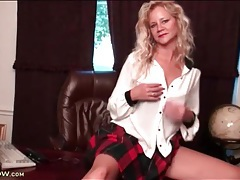 Milf in sexy plaid skirt fondles her tits tubes