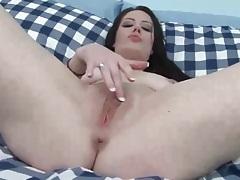 Brunette masturbates with her vibrator tubes