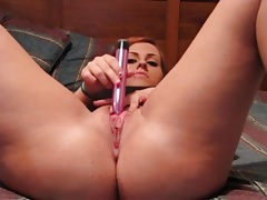 Amateur girl with her legs open fucks a toy tubes