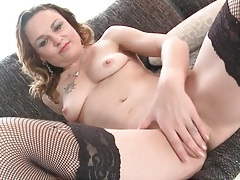 Cute milf in fishnets fingers her hot pussy tubes