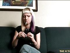 Blonde punk teen lights up a cigarette tubes