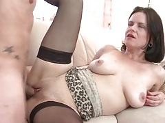 Sexy mom in black stockings takes young dick tubes