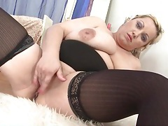 Fatty in black stockings rubs her bald pussy tubes