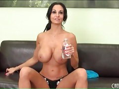 Ava addams rubs oil onto her big titties tubes