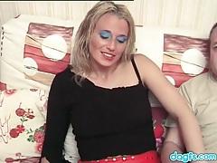 Blonde slut in a sweater sucks their cocks tubes