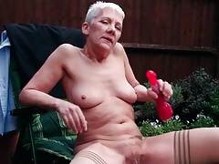 Granny masturbates outdoors with a vibrator tubes