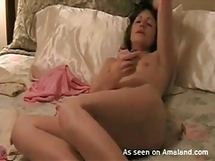 Brunette alone in bed and masturbating lustily tubes