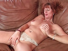 Milf redhead in lace lingerie plays with her tits tubes
