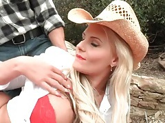 Cowgirl in sexy red lipstick gives a blowjob tubes