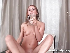 Sexy girl pours clear piss on her head tubes