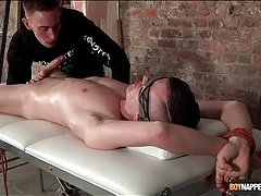 Guy bound to a table gets his cock sucked tubes