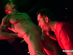 Male stripper gets his dick sucked on stage tubes