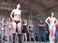 Topless ladies dancing on rock stage tubes