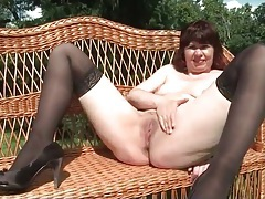 Redheaded mommy outdoors in stockings tubes