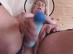 Classy grandma in black lingerie masturbates tubes