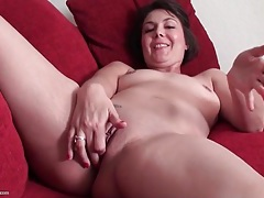 Milf with tight shaved pussy masturbates gently tubes