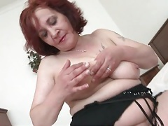 Solo mature redhead plays with her pussy tubes