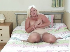 Fat blonde mature rubs lotion into her tits tubes
