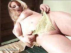 Cute curvy blonde in yellow panties plays tubes