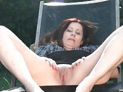 Curvy mature with a gorgeous bald cunt outdoors tubes