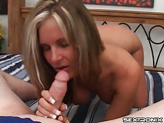 Babe with sexy implants gives hot blowjob tubes