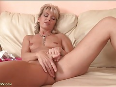Old lady with tiny tits rubs her pussy tubes