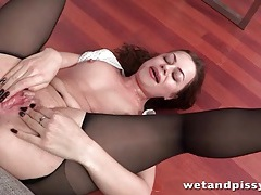 Office cutie in blouse and pantyhose licks piss tubes