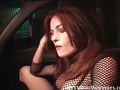 Redhead hooker sucks a dick in the car tubes