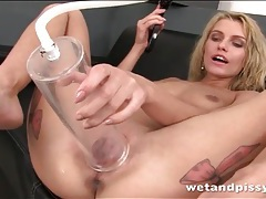 Tattooed tiny tits blonde plays with piss tubes