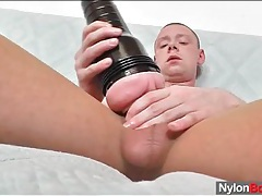 Shaved head guy in pantyhose uses a toy tubes
