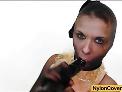 Busty blonde girl encased in black nylon tubes