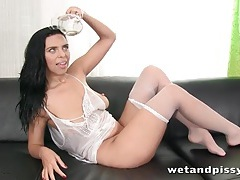 Big breasts brunette is covered in her piss tubes
